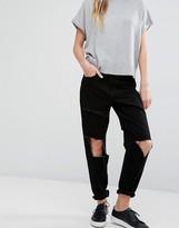 WÅVEN Aki Boyfriend Jeans with Rips and Raw Patch
