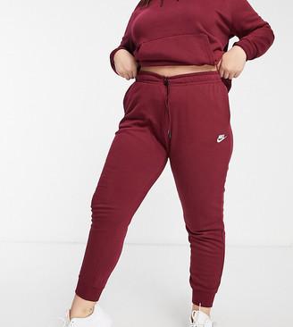 Nike Plus essentials track pants in burgundy