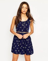 Yumi Belted Skater Dress In Bird Print