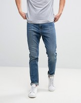 Kiomi Tapered Jeans In Dark Blue Wash