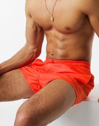 Asos DESIGN swim shorts in neon orange with neon mesh lining super short length