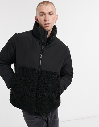 Champion high neck padded jacket in black and grey