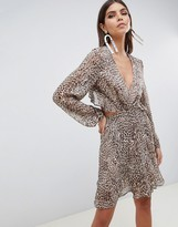 Asos Design DESIGN long sleeve mini dress with open back in Animal print with ruffle details