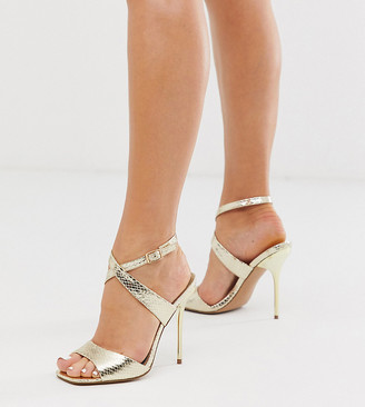 Barely There Asos Design ASOS DESIGN Wide Fit Weave heeled sandals in gold