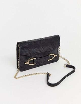 Paul Costelloe real leather black cross body bag with gold hardware and chain