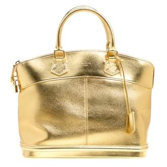 Louis Vuitton Lockit Gold Leather Handbags