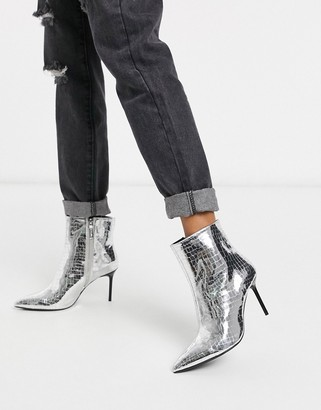 Bershka skinny heeled boots in silver