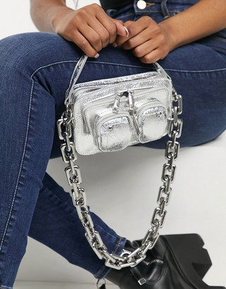 Nunoo Helena vegan-friendly cool cross-body bag with chunky chain in silver