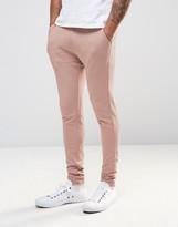 Asos Super Skinny Joggers In Pink