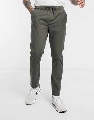 ASOS DESIGN slim chinos with elastic waist in khaki