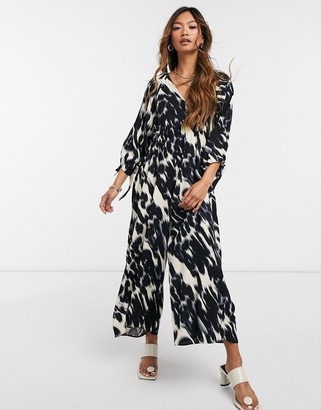 ASOS DESIGN smock jumpsuit with tie sleeve detail in blurred animal print