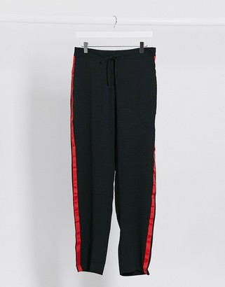 Brave Soul relaxed joggers with red side stripe