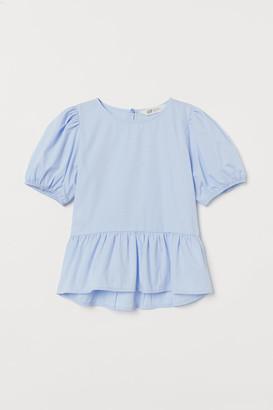 H&M Puff-sleeved peplum blouse