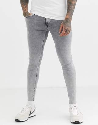 Jack and Jones Intelligence spray on skinny fit raw hem jeans in acid wash gray