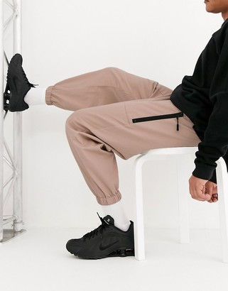 ASOS DESIGN tapered woven sweatpants in pink