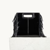 Maje Patent leather bag with fringing
