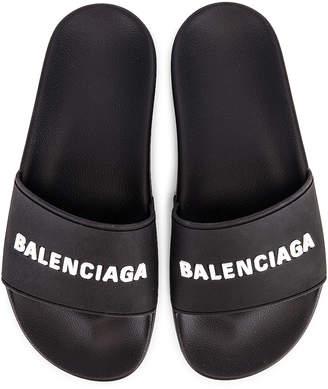 Balenciaga Rubber Logo Pool Slides in Black & White | FWRD