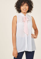 Whether you're going for romance, retro, or general radiance, this ivory tank top will serve you well! Its marvelously micro-pleated collar is bow-fastened with pastel pink ties and its sheer, buttoned-up silhouette is accented with eye-catching clip dots