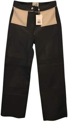 LES COYOTES DE PARIS Black Leather Trousers