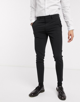 ASOS DESIGN super skinny suit trousers in four way stretch in black