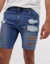 Asos Design DESIGN super skinny denim shorts in mid wash blue with rips