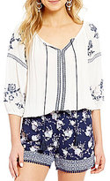 Takara Floral Embroidered 3/4-Sleeve Tie-Neck Sharkbite Hem Peasant Top