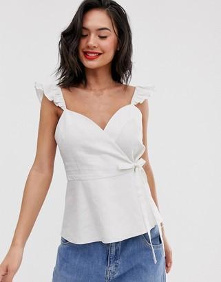 Asos Design DESIGN wrap front cami top with ruffle strap in linen-White