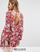 Reclaimed Vintage Open Back Swing Dress In Sparse Floral Print