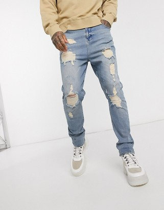 ASOS DESIGN drop crotch jeans in vintage light wash blue with heavy rips