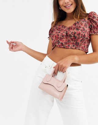 Asos Design DESIGN micro grab bag with curved flap and detachable strap-Pink