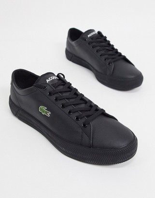 Lacoste gripshot sneakers in black leather