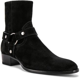 Saint Laurent Wyatt Suede Harness Boots in Black | FWRD