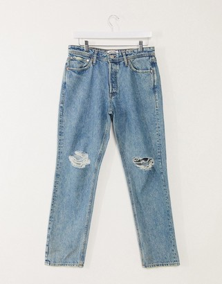 Jack and Jones Intelligence jeans in loose fit with rips in mid blue
