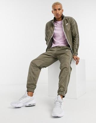 Nike Club woven tracksuit set in khaki