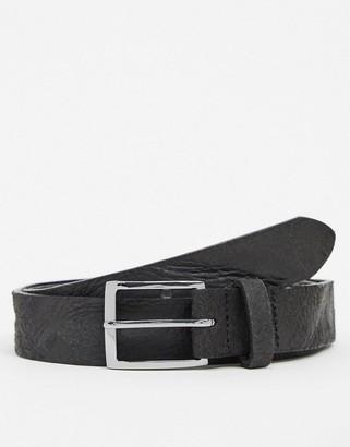 ASOS DESIGN leather slim belt in black with silver buckle & vintage distressing