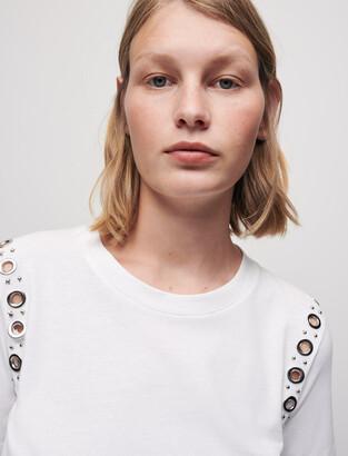 Maje White T-shirt with rock eyelets