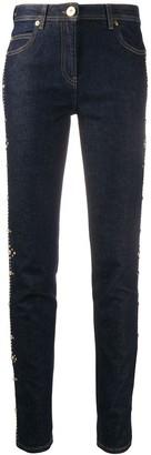 Versace Medusa embellished slim-fit jeans