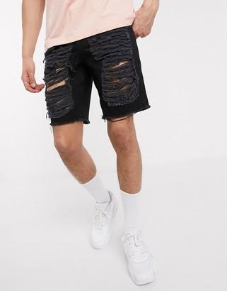ASOS DESIGN slim denim shorts in black with ladder rips