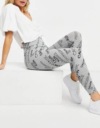 Calvin Klein high waisted legging in all over logo mix print in gray