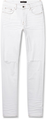 Amiri Slash Skinny-Fit Distressed Stretch-Denim Jeans - Men - White