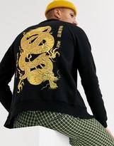 Dragon Optical Asos Design ASOS DESIGN jersey harrington jacket in black with print