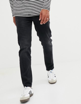ASOS DESIGN 12.5oz tapered jeans in washed black with abrasions