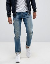 Asos Stretch Slim Jeans In Mid Blue With Abrasions