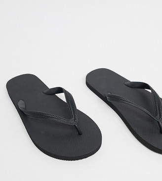 Asos DESIGN Wide Fit flip flops in black