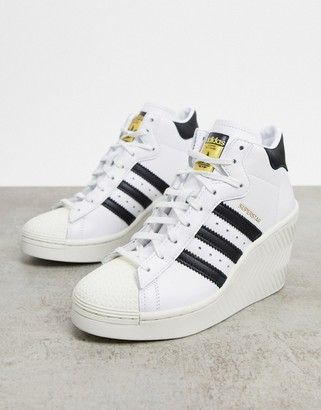 adidas Superstar 80's heeled trainers in white and black