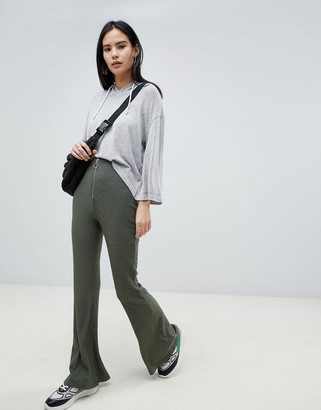 Asos DESIGN 70s rib flare with zip and ring pull
