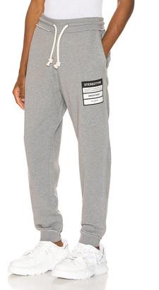 Maison Margiela Stereotype Sweatpants in Grey Melange | FWRD