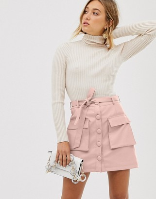 Asos DESIGN button front leather look mini skirt with utility pockets