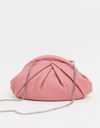 Nunoo Saki leather slouchy pillow clutch with detachable chain strap in pink