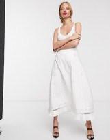 Lost Ink midi skirt with pleated hem and floral applique in cotton